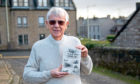 Alex Whyte with the recently published book about Forfar.