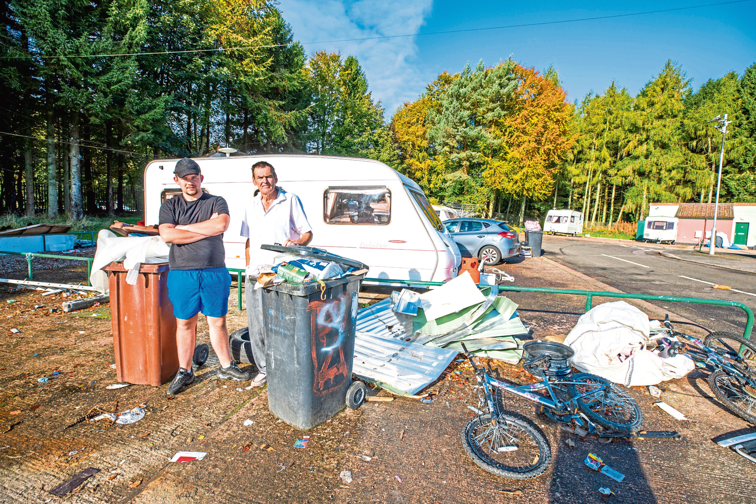 Wallace McPhee (left) and Andrew Kidd alongside some of the discarded items.