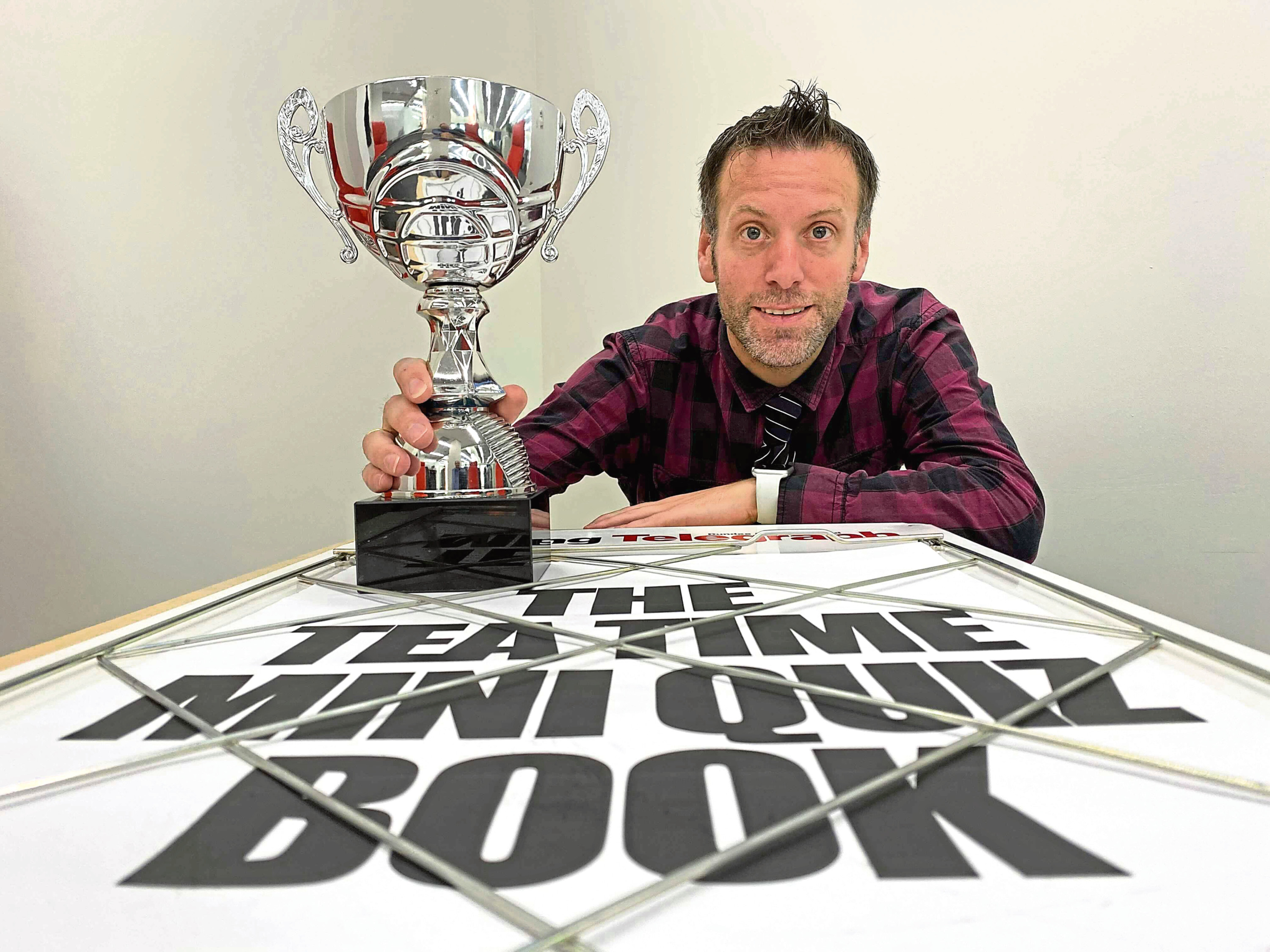 Evening Telegraph Editor Dave Lord with the Tea Time Mini Quiz Trophy.