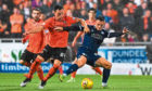 Dundee's Jordan Marshall battles with United's Lawrence Shankland.