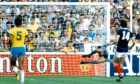 Scotland's Dave Narey sends a shot into the top corner to open the scoring for Scotland against Brazil during the 1982 World Cup in Spain.