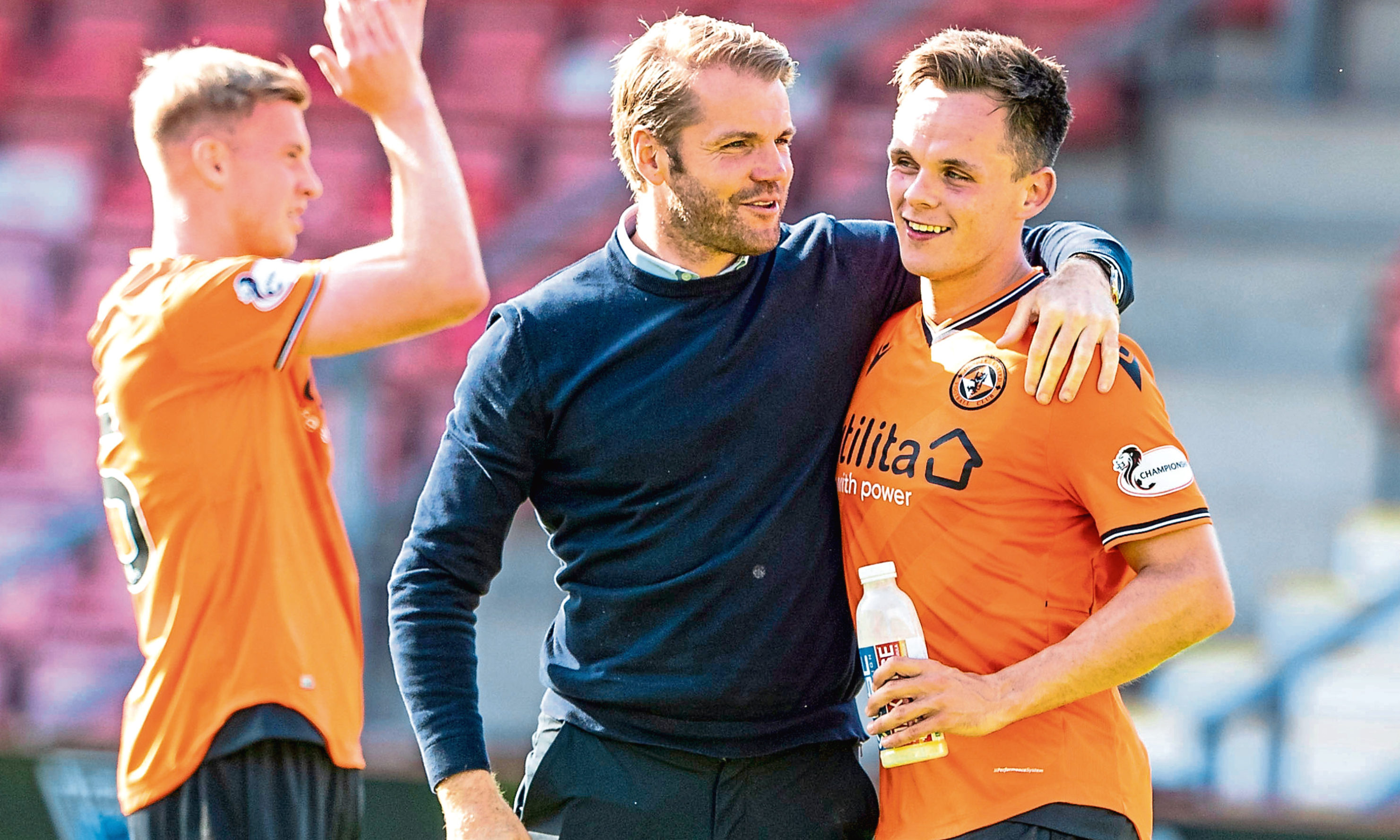 Robbie Neilson with Lawrence Shankland.