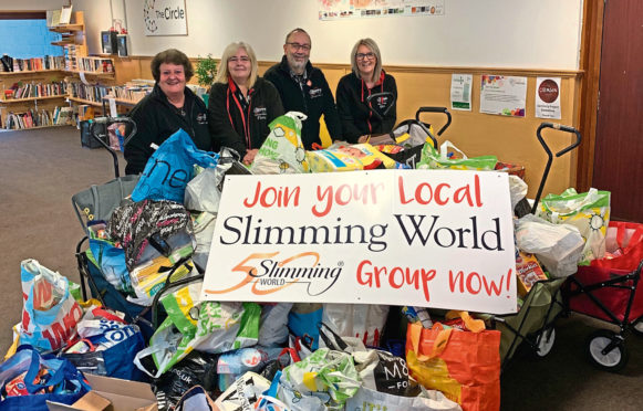 Slimmers Ginevra McComiskie, Fiona McCurdy, David Simpson and Rhonda Mitchell with the donated food.