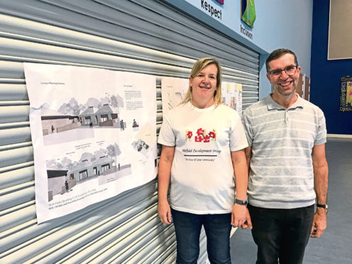 Amanda Symington and Ewan MacGowan with the plans at Ballumbie Primary.