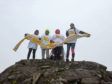 Picture shows Louise Diane, Claire and Terrie at the top of Ben Nevis.