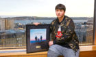 One of the young musicians, Gareth, with his album cover. He recorded a song called Lost Without You.