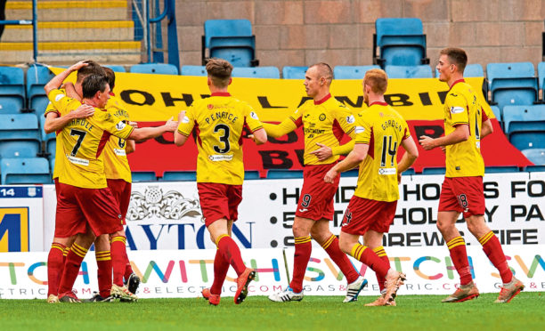 Partick Thistle players celebrate a goal during the Ladbrokes Championship match between Dundee and Partick Thistle at the Kilmac Stadium at Dens Park.