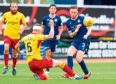 Dundee's Jordan McGhee challenges Sean McGinty (L) during the Ladbrokes Championship match between Dundee and Partick Thistle.