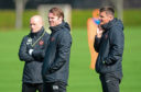 Lee McCulloch alongside Robbie Neilson on the training pitch last year