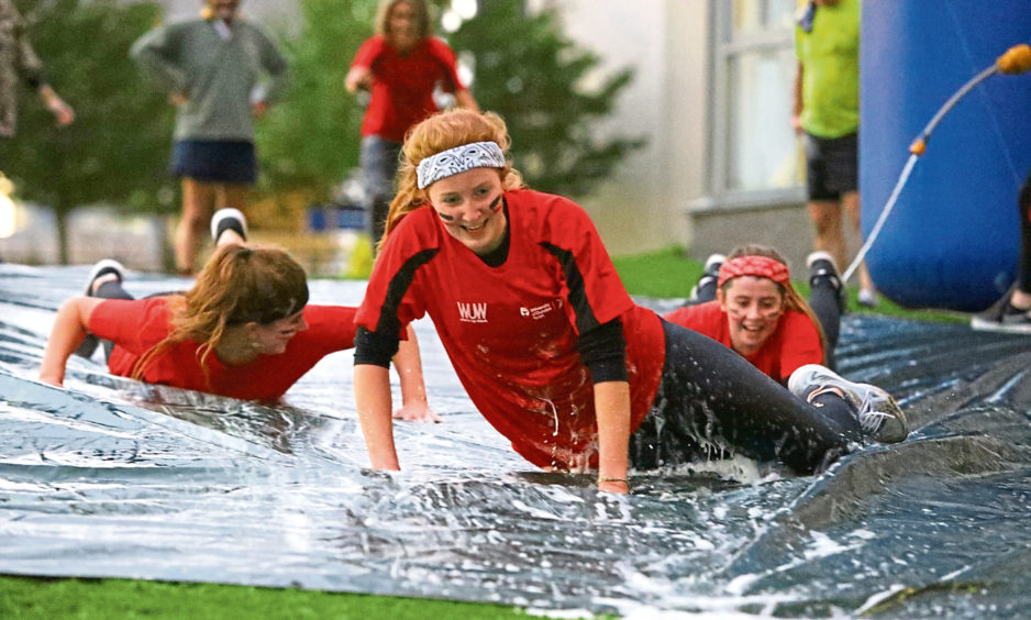 Competitors sliding across the finish at the Brave Runner event.