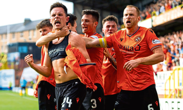 Dundee Utd's Lawrence Shankland celebrates his second goal during the Ladbrokes Championship match between Dundee Utd and Arbroath.