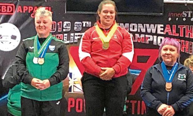 Irene Hallyburton, far right, celebrates powerlifting success.