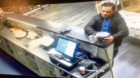 The video shows the man come in, order food, pay by card, then steal the box.