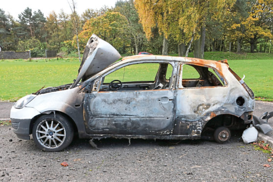 Burnt out car in Whitfield.