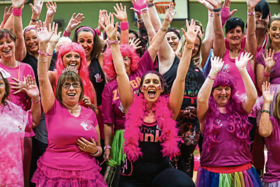 Everyone ready for their class with instructor Gillian Wallace in the feather boa.