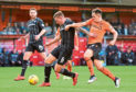 Dundee United's Lawrence Shankland and Dunfermline's Lee Ashcroft in action.