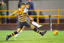 Kane Hemmings bagged a double as Dundee won at Alloa last night.