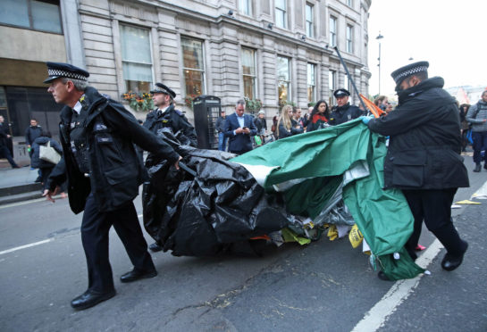 Police removing tents on Whitehall, during the third day of an Extinction Rebellion (XR) protest in Westminster.