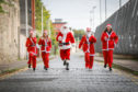 Santas Linda Meiklejohn from the ARCHIE Foundation, Sherridan Samson, Garry Smith, Steph Fender and Niamh Paterson, in training for the Santa Dash, Dundee.