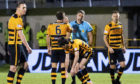 The Alloa Athletic players appeal to referee Greg Aitken following the sending off of Iain Flannigan.