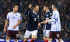 Lawrence Shankland  celebrating his first international goal for the senior side.