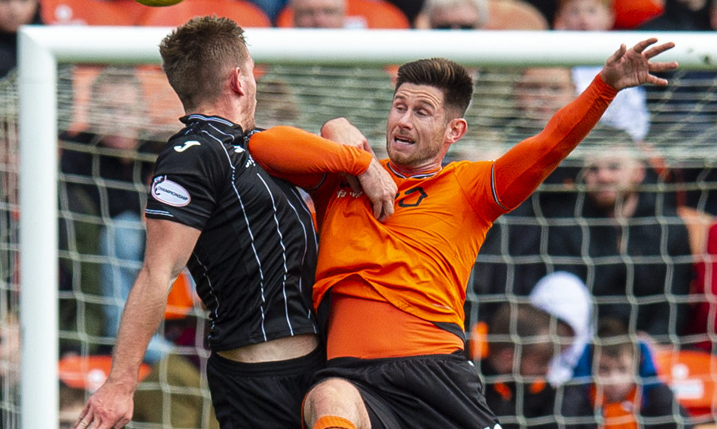 Calum Butcher and Dunfermline's Lee Ashcroft in action.