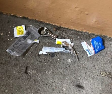 Drugs paraphernalia found by residents in the close.
