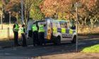 Police in Etive Gardens.