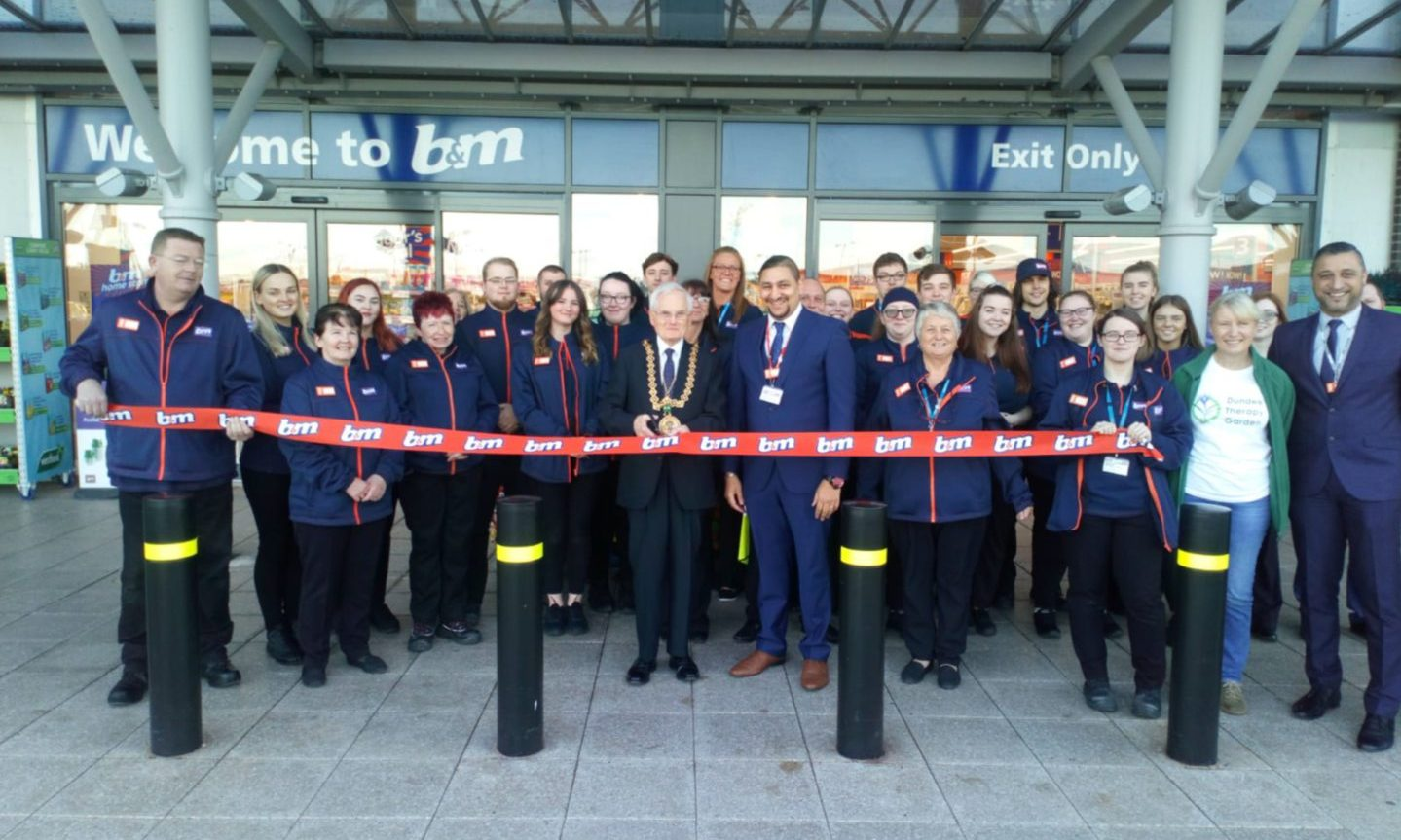Dundee Lord Provost Ian Borthwick cuts the ribbon at the new B&M store.