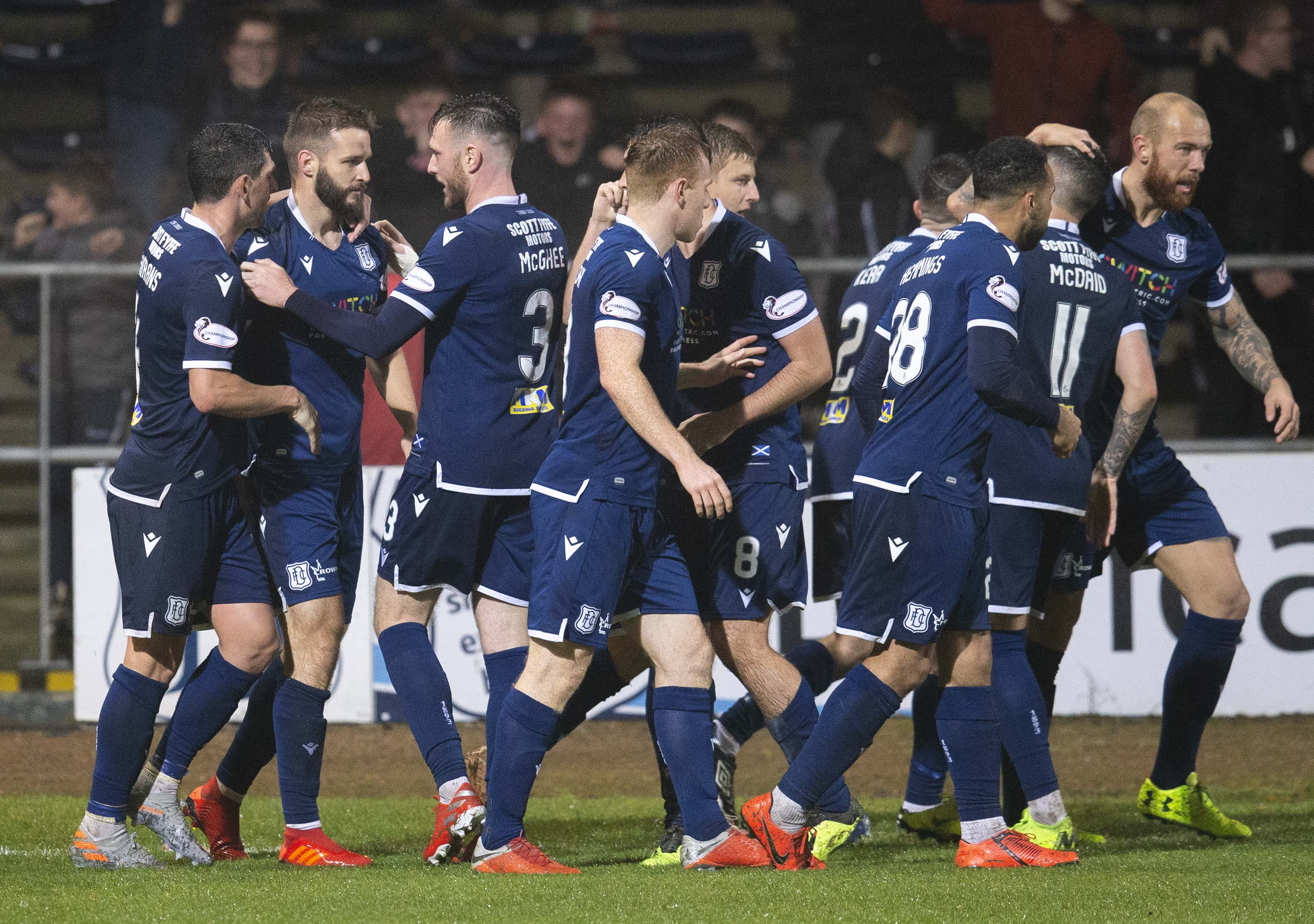 Jamie Ness is congratulated on his winner by his Dundee team-mates.
