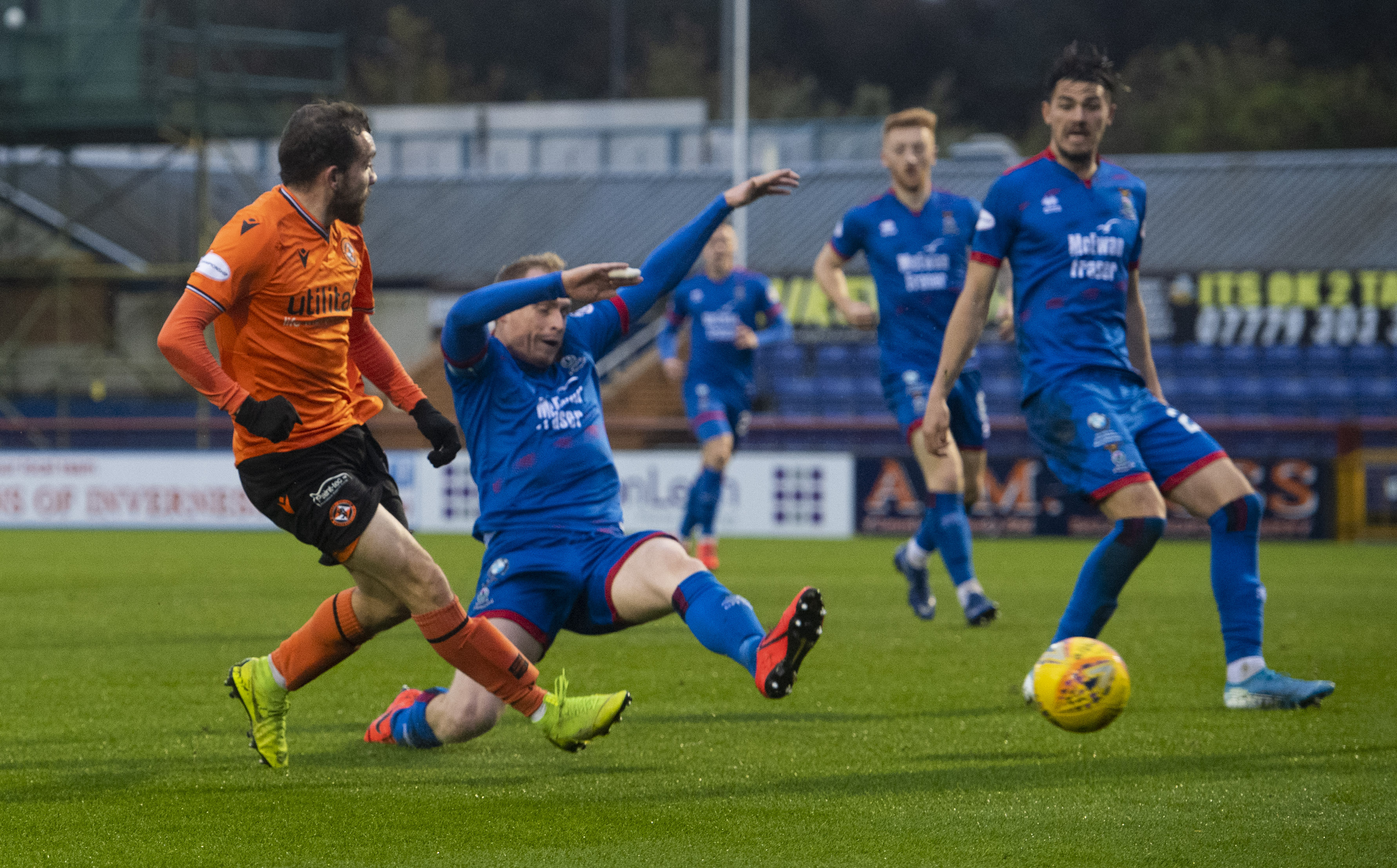 Dundee Utd's Paul McMullan's shot is deflected into the goal off Inverness' Shaun Rooney to make it 1-0.