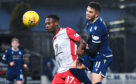 Dundee's Declan McDaid (R) and Queen of the South's Abdul Osman in action at Dens Park.