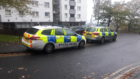 Police cars pictured outside Tulloch Court.