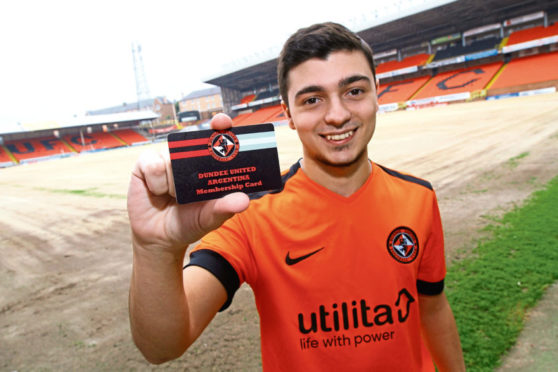 Agustin Mervic from Buenos Aires shows off his Dundee United Argentina supporters Club card at Tannadice.
