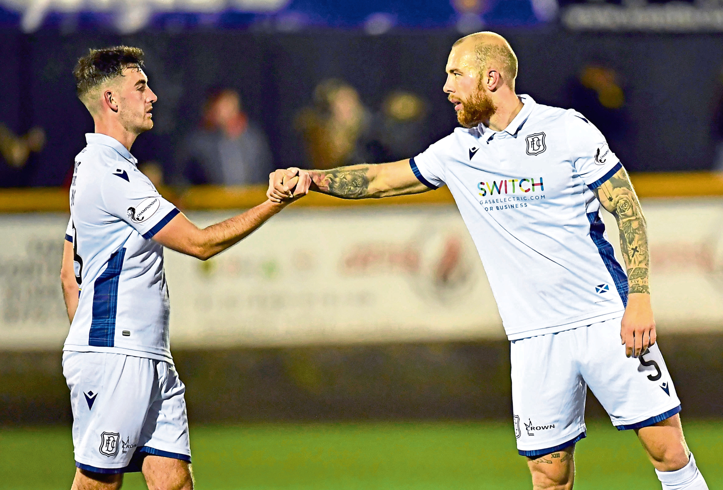 Dundee's Jordon Forster (right) celebrates with Shaun Byrne at full time of the Ladbrokes Championship match between Alloa Athletic and Dundee.