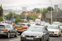 Busy traffic on Lochee Road in Dundee for story about Low Emission zone.