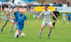 Alan Tulleth in possession for Lochee United against Hermes.