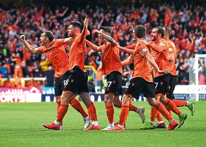 Dundee United's Calum Butcher (centre) celebrates a goal.