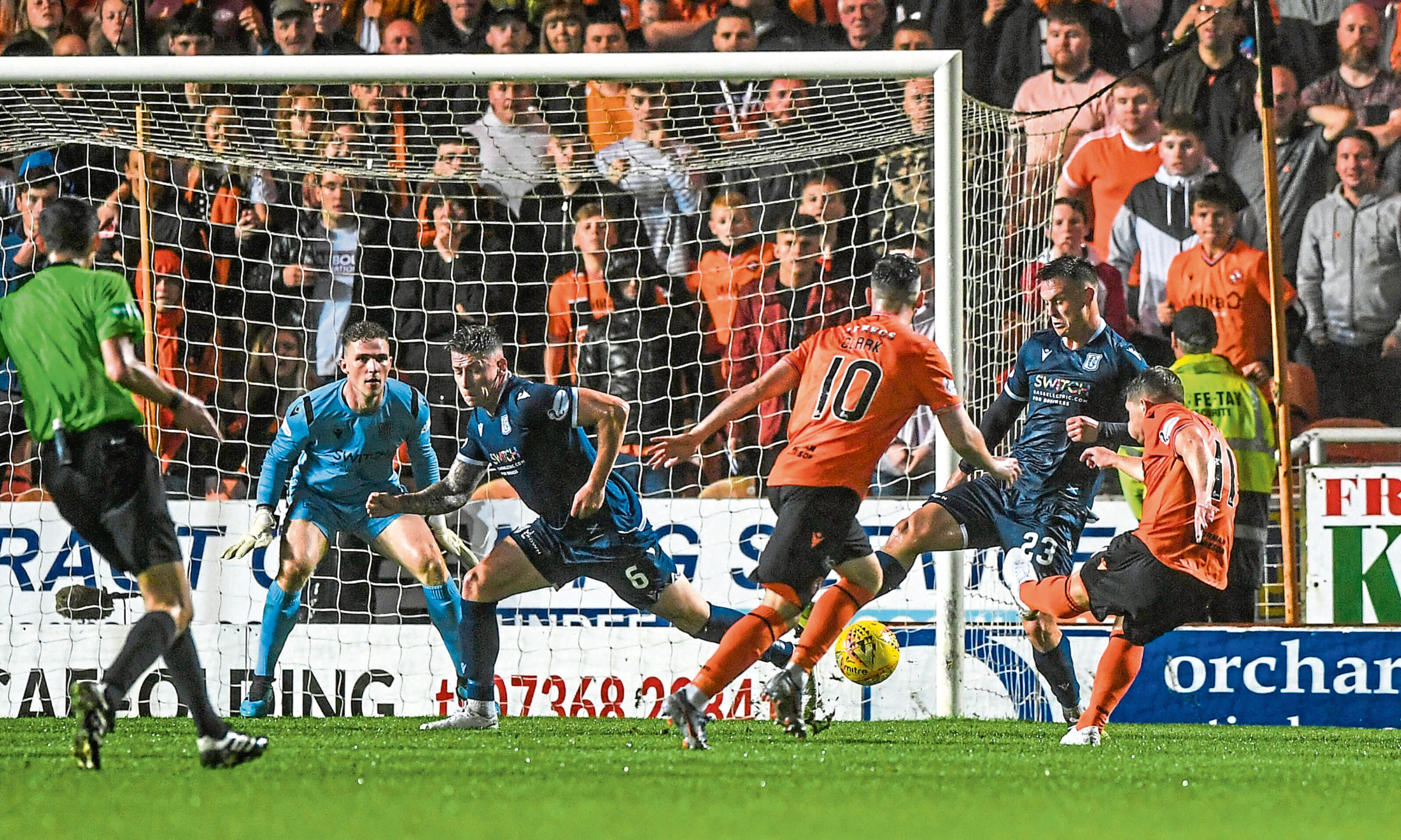 United's Cammy Smith scores to make it 6-2 during the Dundee derby in August.