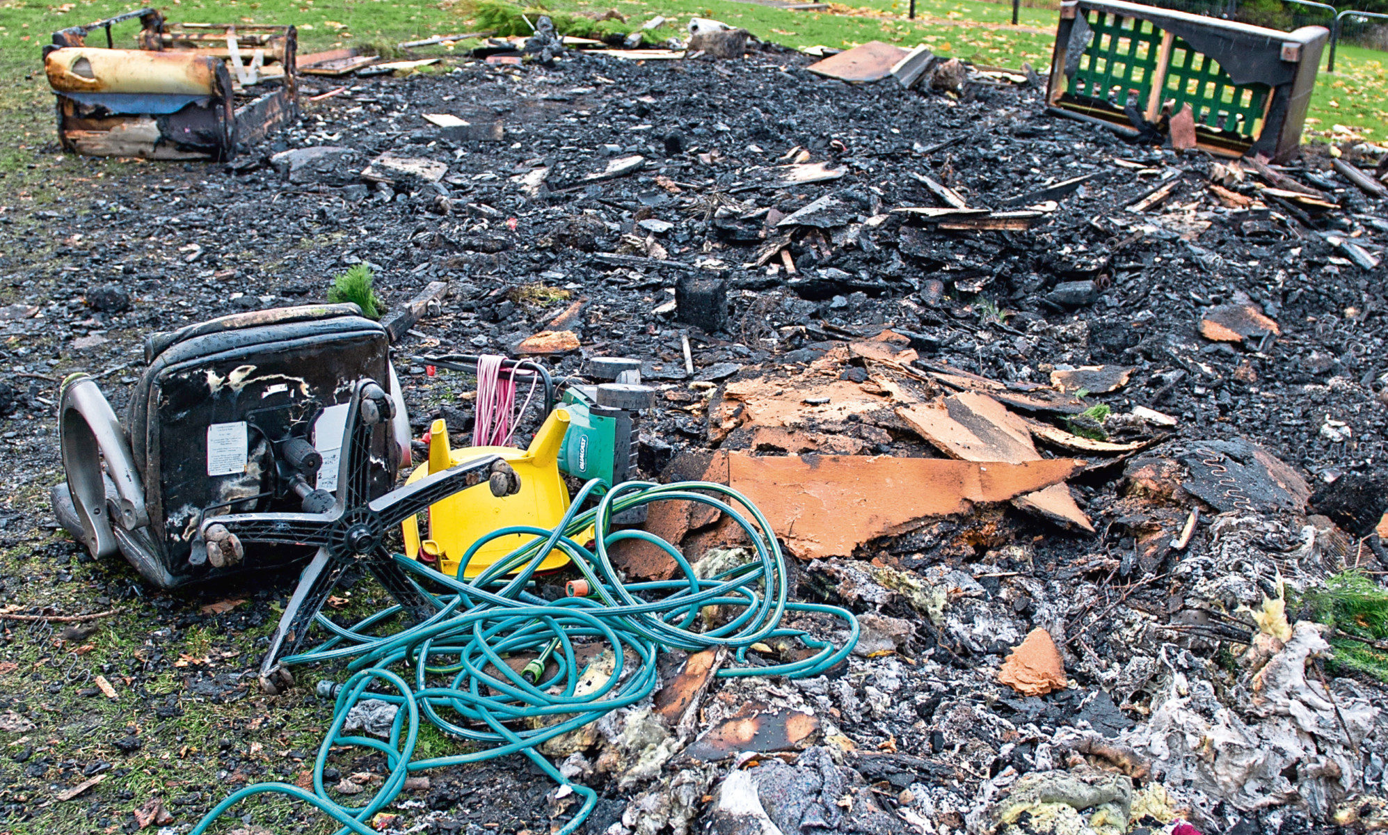 The charred mess and debris left after the bonfire in Kirkton, which firefighters were forced to put out.