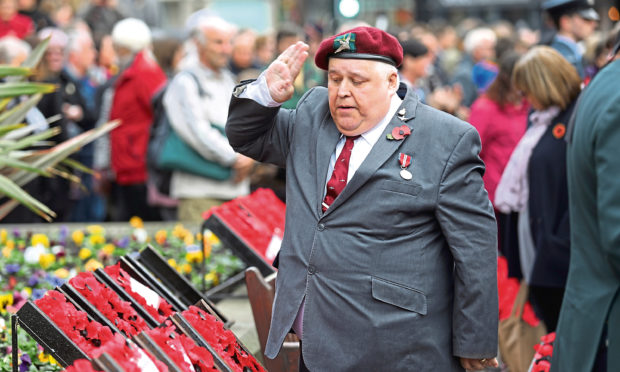 A salute to the wreaths at a parade on Remembrance Sunday 2018.