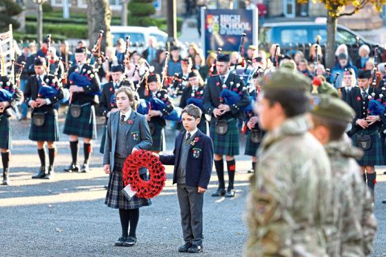 Junior school wreath bearers Freya Galvin and Sam Brass preparing to lay their tribute.