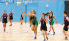 Action from a netball game at the sports centre.