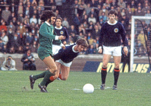 Northern Ireland's George Best wins the ball from Hugh Curran in the 1971 Home Championships.