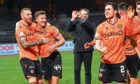 The Dundee United players celebrate at full-time at Dens on Friday.