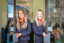 Leanne Gall and Megan Wright opening the doors of Hays Travel in Dundee.