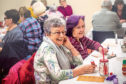 Some of the pensioners enjoy the bingo.