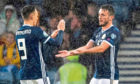 Lawrence Shankland's (left) fellow-Scotland international John McGinn                            (right) was subject of interest from the Dundee United hitman's suitors Nottingham Forest in 2018.