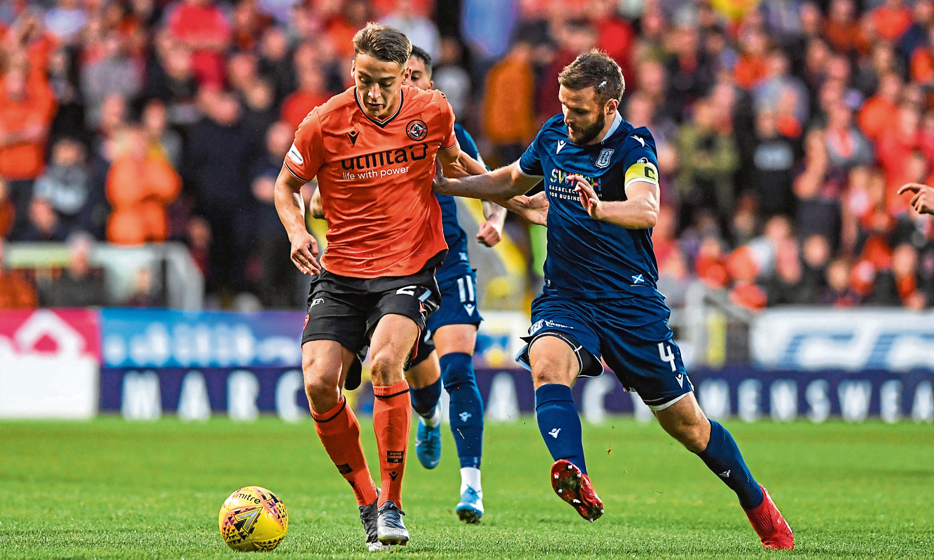Dundee United's Louis Appere battles with Dundee's Jamie Ness.