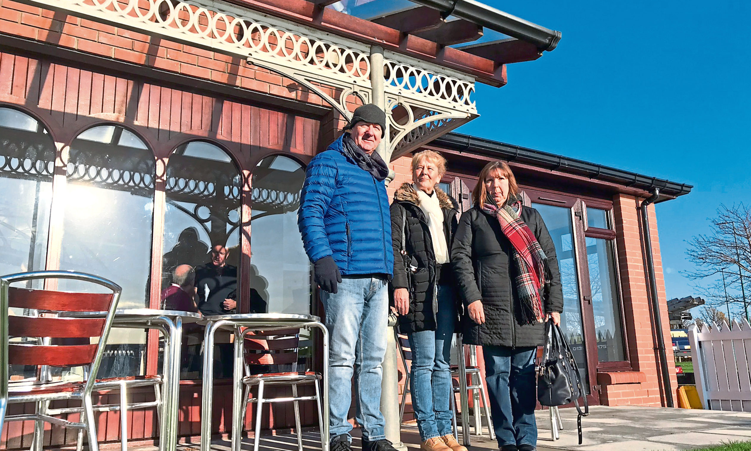Brother David Fox, sister Isobel and sister-in-law Aileen, along with some of Brian's metalwork at the Bridgeview Station cafe in Dundee.